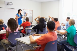 Can teachers take classes at their local college while teaching?
