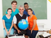 male teacher holding a globe