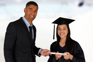 Principal gives a student her diploma