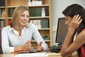 School administrator talks to a student